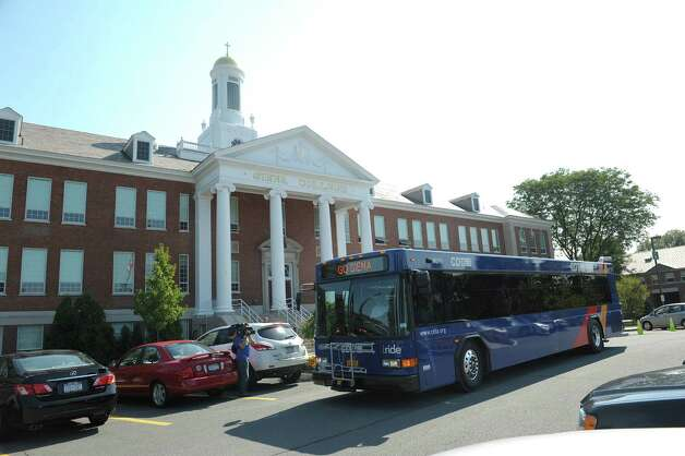 A CDTA bus pulls away from the curb at Siena College for a ceremonial trip around the area during a press event on Monday, Sept. 17, 2012 in Loudonville, NY.   CDTA and Siena announced a new program that gives Siena students access to the CDTA route system. (Paul Buckowski / Times Union) Photo: Paul Buckowski