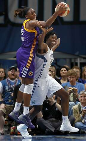 Nneka Ogwumike (left) of the Los Angeles Sparks tangles with Minnesota's Amber Harris. Photo: Carlos Gonzalez, McClatchy-Tribune News Service