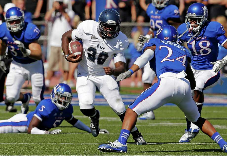 After missing most of the 2011 season because of a hamstring injury, Rice running back Charles Ross (28) has come back strong, including a 94-yard game and key fourth-quarter touchdown against Kansas. Photo: Charlie Riedel / AP