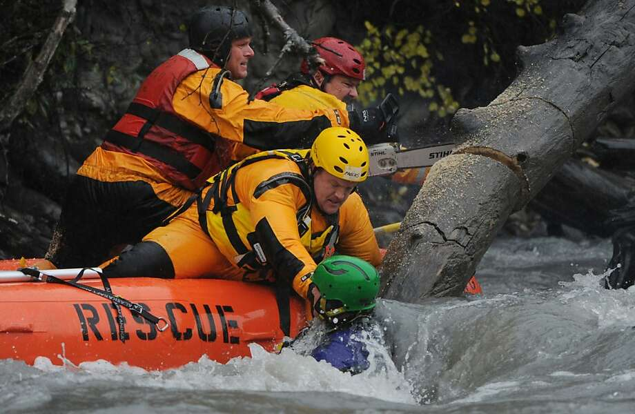 The Anchorage Fire Department performs a swiftwater rescue on Eagle River on Sunday, Sept. 16, 2012, in Anchorage, Alaska. The team freed a paddler who was trapped in a kayak pinned under a fallen tree.  (AP Photo/Anchorage Daily News, Bill Roth)   LOCAL TV OUT (KTUU-TV, KTVA-TV) LOCAL PRINT OUT (THE ANCHORAGE PRESS, THE ALASKA DISPATCH) Photo: Bill Roth, Associated Press