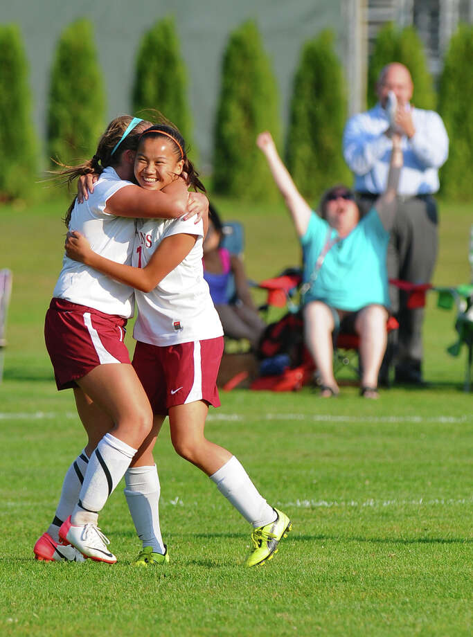 Scotia-Glenville's Gracie Mailey, right, celebrates with teammate Abby O'Connor, left, after Gracie scored her team's third goal against Queensbury during a game on Monday Sept. 17, 2012 in Scotia, NY.   (Philip Kamrass / Times Union) Photo: Philip Kamrass / 00019293A