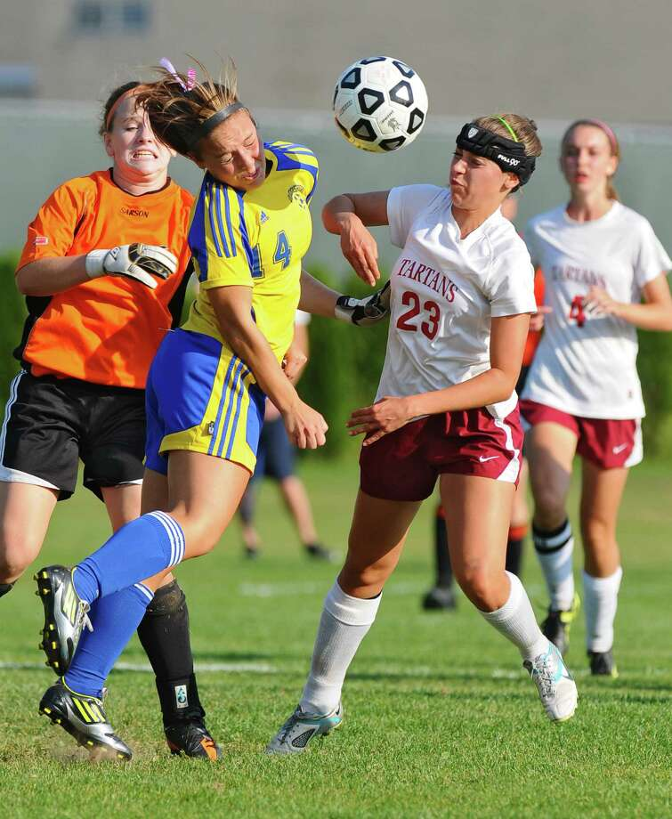 Scotia-Glenville's Grace Marola, right, battles Queensbury's Lorissa Rodriguez, left, during a game on Monday Sept. 17, 2012 in Scotia, NY.   (Philip Kamrass / Times Union) Photo: Philip Kamrass / 00019293A