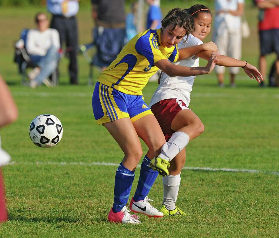 Scotia-Glenville's Gracie Mailey, right, battles Queensbury's Tess Fagle, left,  during a game on Monday Sept. 17, 2012 in Scotia, NY.   (Philip Kamrass / Times Union) Photo: Philip Kamrass / 00019293A