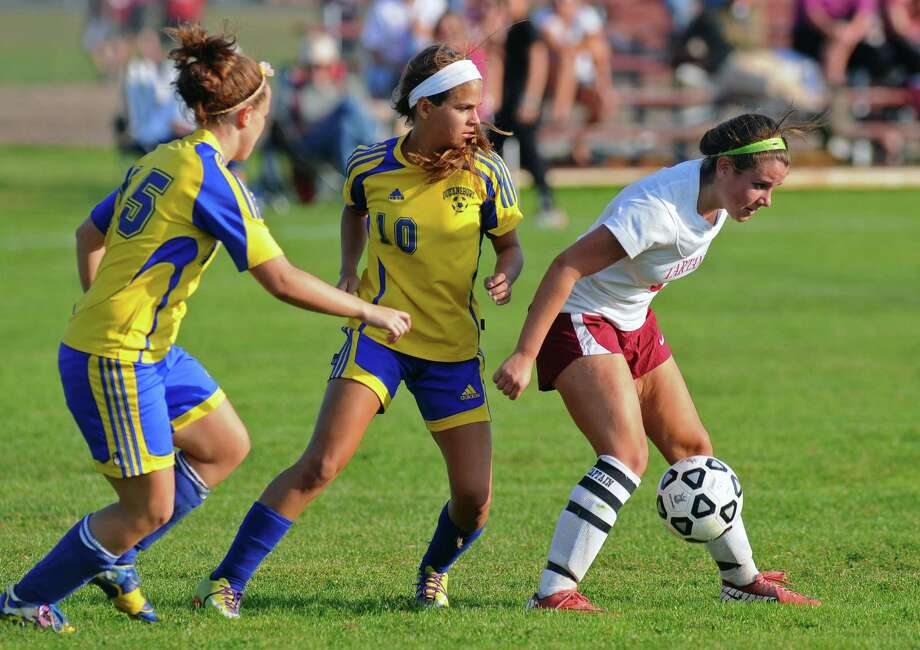 Scotia-Glenville's Morgan Bailey, right, battles Queensbury's Colleen Rice, left,  and Katie Shevlin, center, during a game on Monday Sept. 17, 2012 in Scotia, NY.   (Philip Kamrass / Times Union) Photo: Philip Kamrass / 00019293A