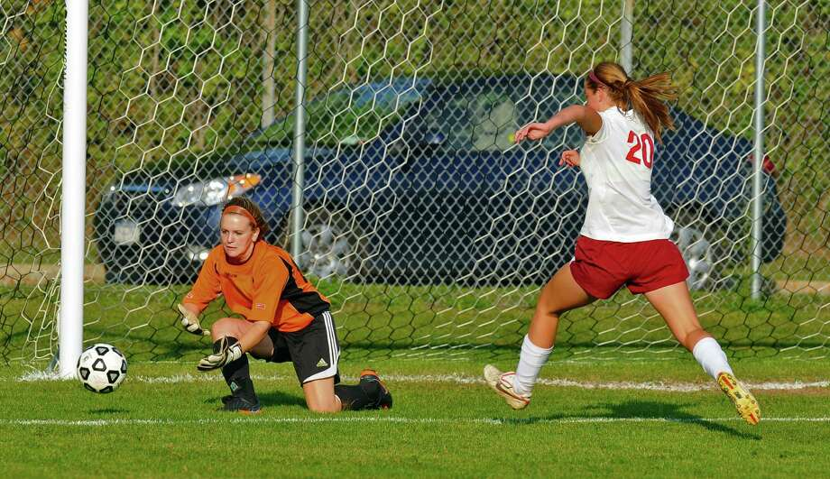 Queensbury goalkeeper Sarah O'Brien makes a stop with Scotia-Glenville's Maddy Carroll in pursuit, right, during a game on Monday Sept. 17, 2012 in Scotia, NY.   (Philip Kamrass / Times Union) Photo: Philip Kamrass / 00019293A