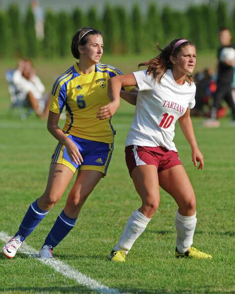 Scotia-Glenville's Sophie Constantino, right, battles Queensbury's Tess Fagle for position during a