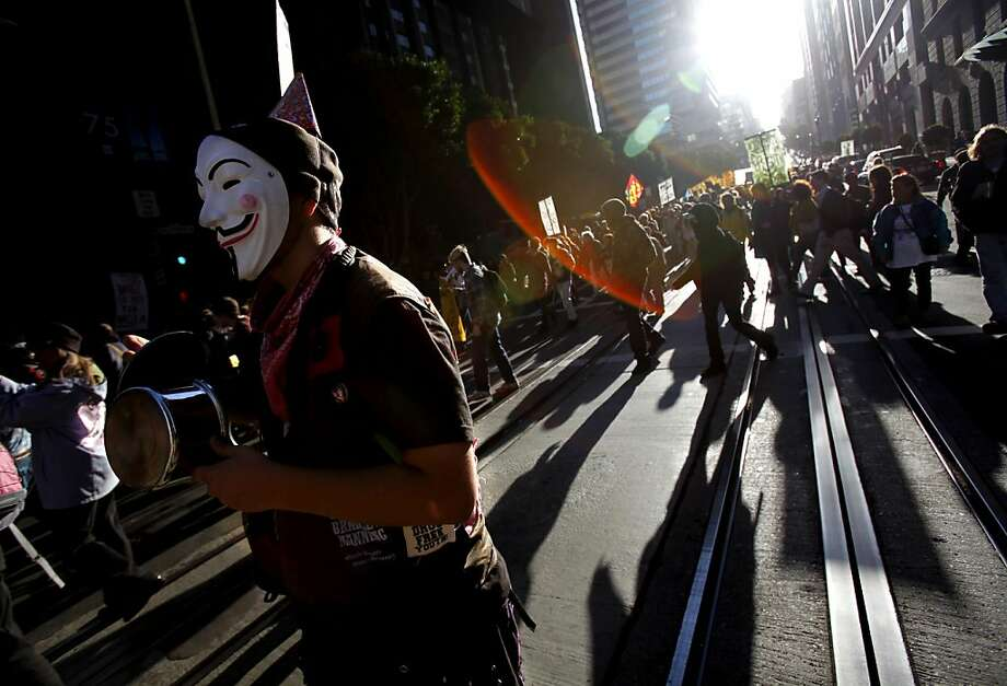 With some wearing birthday hats, Occupy protestors take to the streets to celebrate the one-year anniversary of the Occupy movement in San Francisco, Calif., Monday, September 17, 2012. Photo: Sarah Rice, Special To The Chronicle