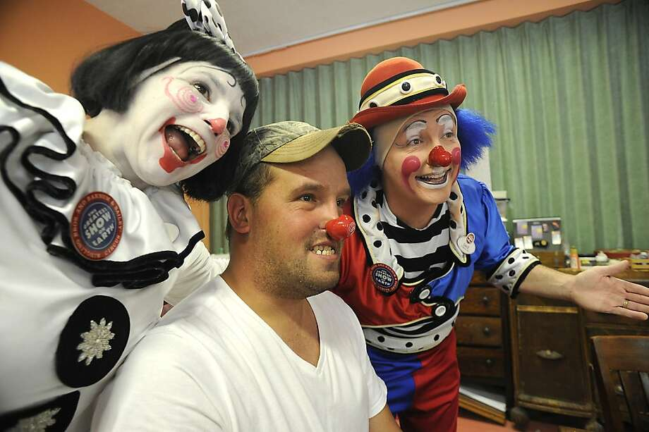 Cherie and Dave, clowns with the Ringling Bros. and Barnum and Bailey Circus, have a picture taken with Shawn Lambert, a special needs art student at Arts Universe in Wilkes-Barre, Pa., Monday, Sept. 17, 2012. The clowns were in Wilkes-Barre were appearing in Wilkes-Barre in advance of the circus' appearance at the Mohegan Sun Arena in November. (AP Photo/The Citizens' Voice, Mark Moran)  MANDATORY CREDIT Photo: Mark Moran, Associated Press