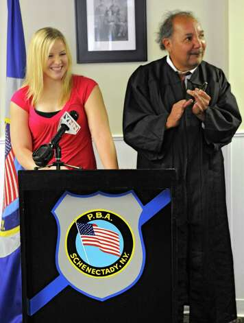 The Eric J. Verteramo Scholarship winner Marley Gigler receives her scholarship of $5,000 from Schenectady City Court Judge Guido Loyola at the Schenectady PBA Union Hall Tueday, Aug. 21, 2012 in Schenectady, N.Y. She will attending Suny Brockport and majoring in criminal justice. She is a resident of Rotterdam and graduated from Schalmont H.S. (Lori Van Buren / Times Union) Photo: Lori Van Buren