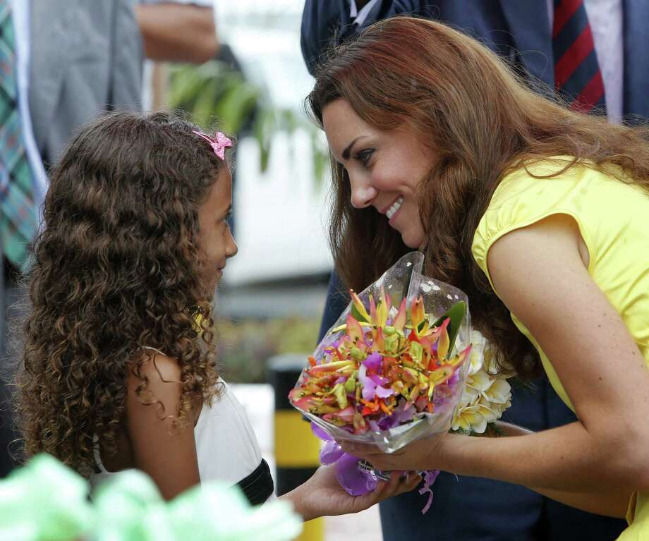 HONIARA, SOLOMON ISLANDS - SEPTEMBER 17:  Catherine, Duchess of Cambridge receives flowers from a young well-wisher during a visit to the Coast Watcher and Solomon Scouts Memorial on day 7 of their Diamond Jubilee Tour, on September 17, 2012 in Honiara, Solomon Islands. Prince William, Duke of Cambridge and Catherine, Duchess of Cambridge arrived in the Solomon Islands as the first stop of the Pacific leg of their nine day Diamond Jubilee Tour of the Far East and South Pacific. Photo: Pool, Getty Images / 2012 Getty Images