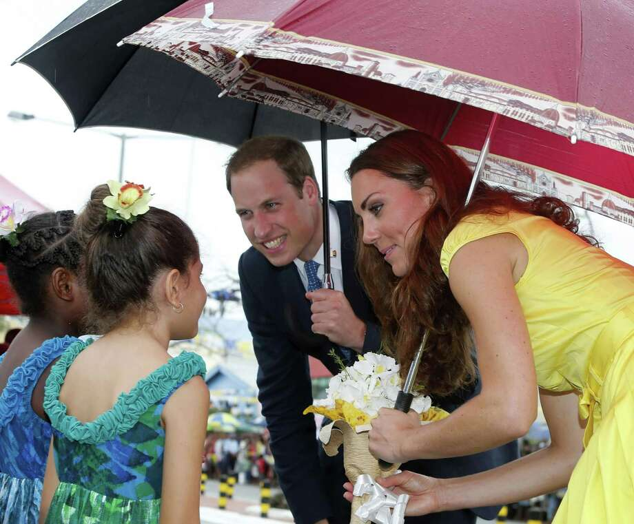 HONIARA, SOLOMON ISLANDS - SEPTEMBER 17:  Prince William, Duke of Cambridge and Catherine, Duchess of Cambridge meet young well-wishers during a visit to the Coast Watcher and Solomon Scouts Memorial on day 7 of their Diamond Jubilee Tour, on September 17, 2012 in Honiara, Solomon Islands. Prince William, Duke of Cambridge and Catherine, Duchess of Cambridge arrived in the Solomon Islands as the first stop of the Pacific leg of their nine day Diamond Jubilee Tour of the Far East and South Pacific. Photo: Pool, Getty Images / 2012 Getty Images