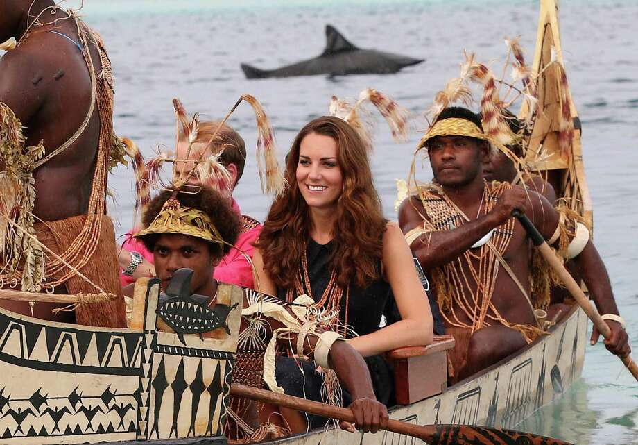 HONIARA, GUADALCANAL ISLAND, SOLOMON ISLANDS - SEPTEMBER 17:  Catherine, Duchess of Cambridge and Prince William, Duke of Cambridge are followed by locals dressed as 'sharks' as they travel in a traditional canoe during a visit to Tuvanipupu Island on their Diamond Jubilee tour of the Far East on September 17, 2012 in Honiara, Guadalcanal Island. Prince William, Duke of Cambridge and Catherine, Duchess of Cambridge are on a Diamond Jubilee tour representing the Queen taking in Singapore, Malaysia, the Solomon Islands and Tuvalu. Photo: Chris Jackson, Getty Images / 2012 Getty Images