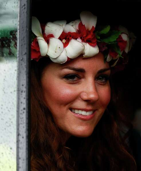 Britain's Kate, the Duchess of Cambridge, smiles to locals as she departs the Cultural village in Ho