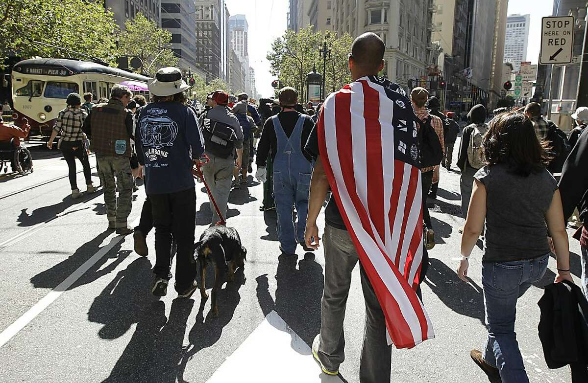 Protestors celebrating the one year anniversary of the Occupy Movement march down Market Street to the financial district in San Francisco, Monday, Sept. 17, 2012. (AP Photo/Ben Margot)
