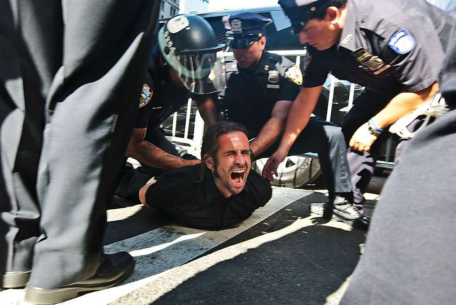 Protester Chris Phillips is arrested by the NYPD as protesters take to Lower Manhattan to celebrate the first Anniversary of the Occupy Wall Street movement in Manhattan, New York on September 17, 2012. (Byron Smith/Zuma Press/MCT) Photo: Bryan Smith, McClatchy-Tribune News Service