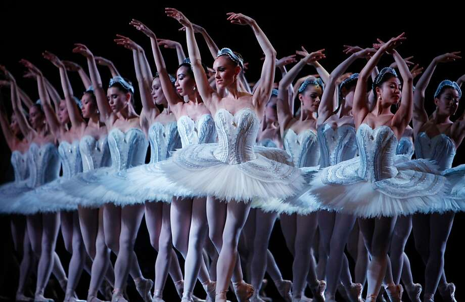 """Dancers from the Australian Ballet perform a new traditional production of """"Swan Lake"""" by choreographer Stephen Baynes in Melbourne on September 17, 2012. The new production of Swan Lake, which was the first ever ballet performed by the Australian Ballet in 1962, will have its world premiere production on September 18 before heading to Sydney on November 30 as the company celebrate's its 50th birthday.     AFP PHOTO / CAROLINE PANKERTCAROLINE PANKERT/AFP/GettyImages Photo: Caroline Pankert, AFP/Getty Images"""