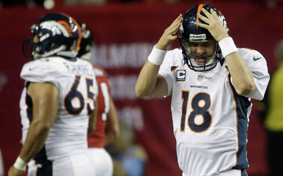 Denver Broncos quarterback Peyton Manning (18) reacts after being sacked by the Atlanta Falcons during the first half of an NFL football game, Monday, Sept. 17, 2012, in Atlanta. (AP Photo/John Bazemore) Photo: John Bazemore, Associated Press / AP