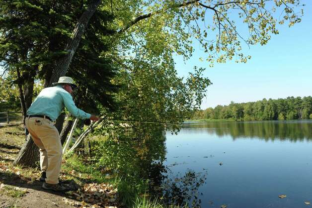 Ken Merkelbach of Albany casts his fly rod into  Rensselaer Lake on Monday, Sept. 17, 2012 in Albany, NY.  Merkelbach says that he considers himself an urban fisherman, he likes to fish waters in and around cities and towns. (Paul Buckowski / Times Union) Photo: Paul Buckowski