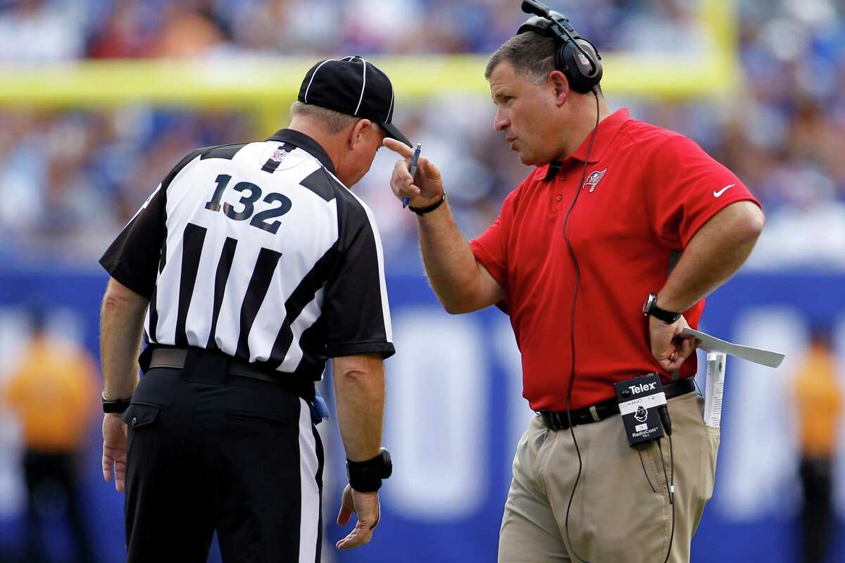 Tampa Bay Buccaneers head coach Greg Schiano, right, talks to referee John Parry (132) during an NFL football game against the New York Giants Sunday, Sept. 16, 2012, in East Rutherford, N.J. (AP Photo/Julio Cortez)