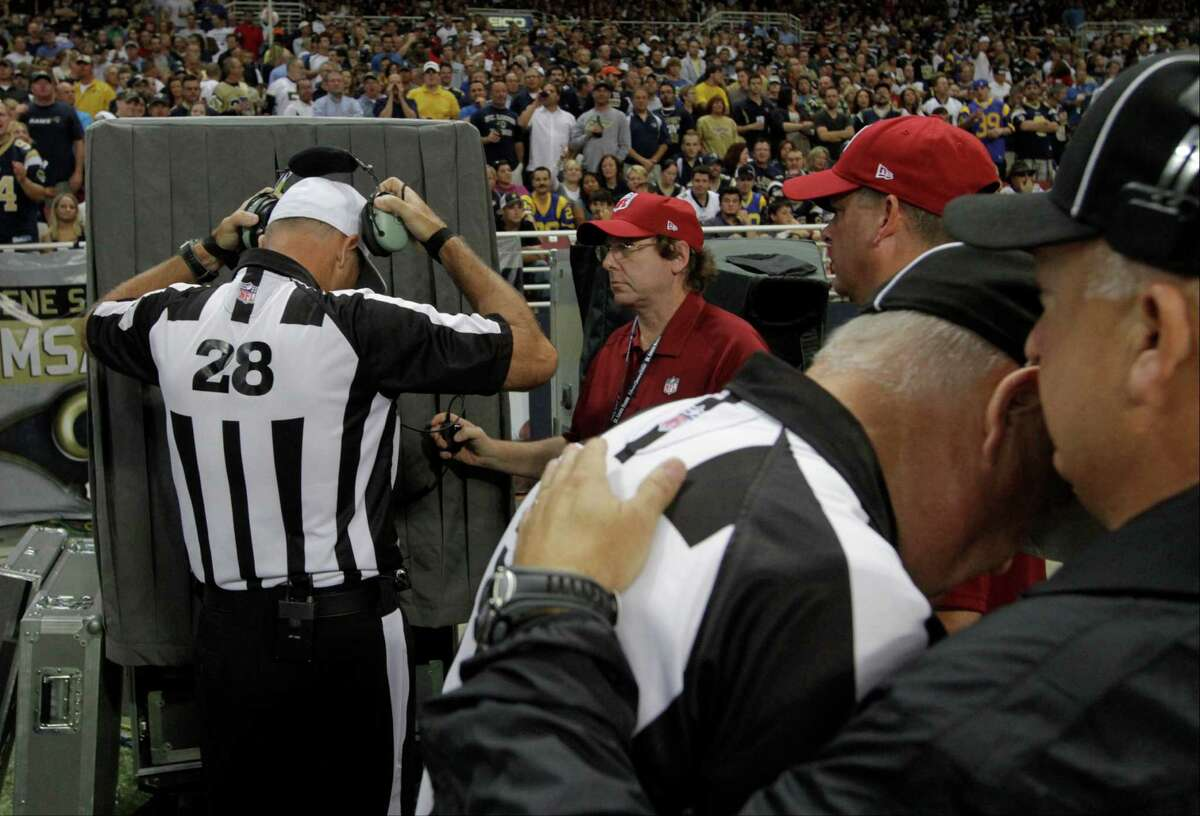 Referee Wayne Elliott (28) prepares to review a play during the fourth quarter of an NFL football game between the St. Louis Rams and the Washington Redskins Sunday, Sept. 16, 2012, in St. Louis. The Rams won 31-28. (AP Photo/Seth Perlman)