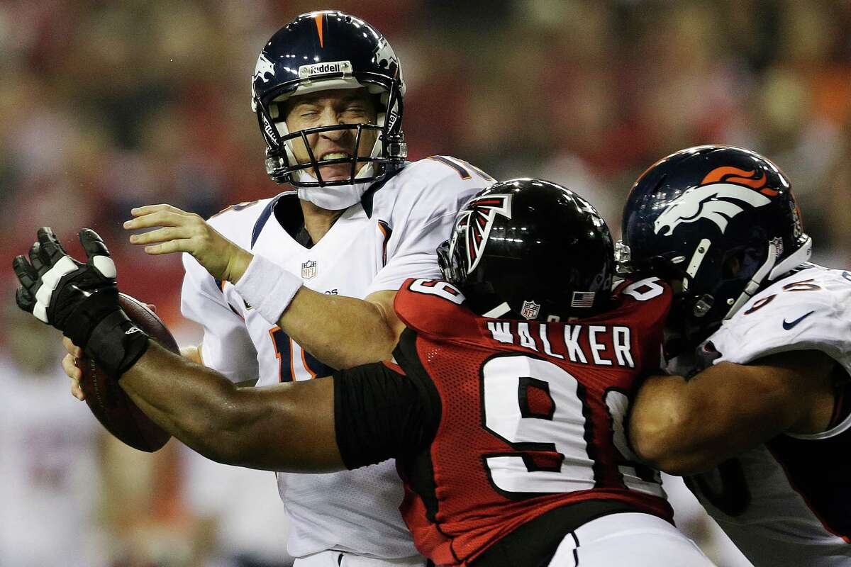 In addition to picking off three passes from Peyton Manning, the Falcons also sacked him three times, including this one by Vance Walker.
