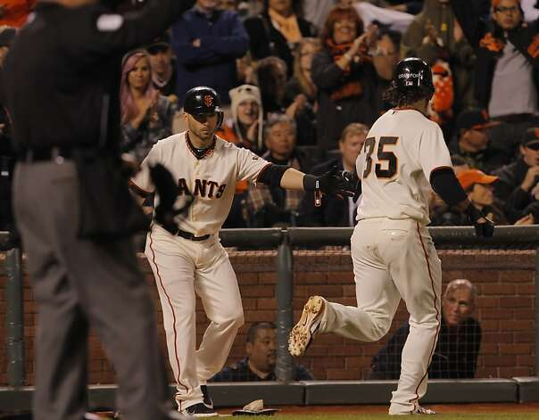 Brandon Crawford is congratulated by Marco Scutaro after scoring in the third inning. The San Francisco Giants played the Colorado Rockies at AT&T Park in San Francisco, Calif., on Monday, September 17, 2012. Photo: Carlos Avila Gonzalez - San Fran, The Chronicle