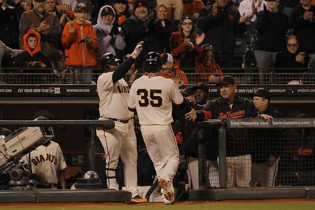Brandon Crawford is greeted at the dugout after scoring in the third inning. The San Francisco Giants played the Colorado Rockies at AT&T Park in San Francisco, Calif., on Monday, September 17, 2012. Photo: Carlos Avila Gonzalez - San Fran, The Chronicle