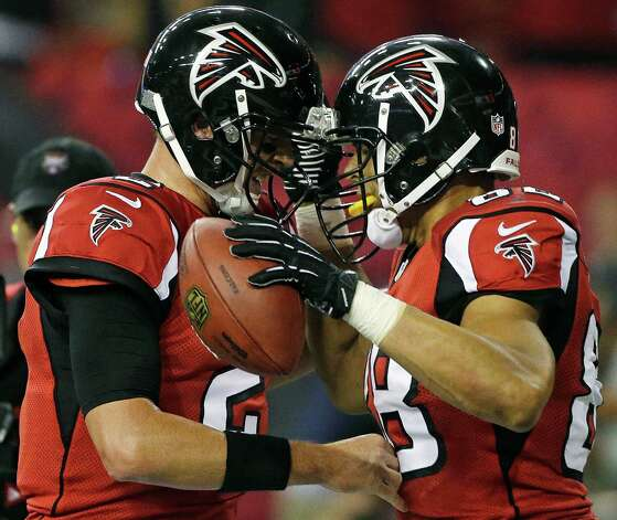 Atlanta Falcons quarterback Matt Ryan (2) and tight end Tony Gonzalez, right, celebrate after a touchdown during the first half of an NFL football game against the Denver Broncos, Monday, Sept. 17, 2012, in Atlanta. (AP Photo/John Bazemore) Photo: John Bazemore