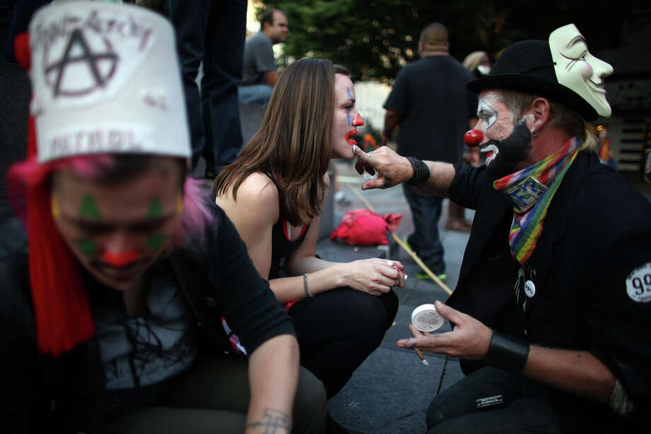 Angela Vogel has her face painted before a march on the first anniversary of the Occupy movement on Monday, September 17, 2012 at Westlake Park. Photo: JOSHUA TRUJILLO / SEATTLEPI.COM