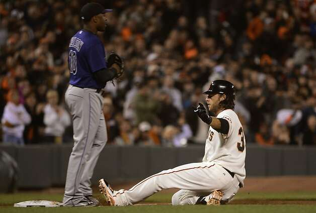 SAN FRANCISCO, CA - SEPTEMBER 17:  Brandon Crawford #35 of the San Francisco Giants slides into third base with a triple as Chris Nelson #10 of the Colorado Rockies looks on in the third inning at AT&T Park on September 17, 2012 in San Francisco, California.  (Photo by Thearon W. Henderson/Getty Images) Photo: Thearon W. Henderson, Getty Images