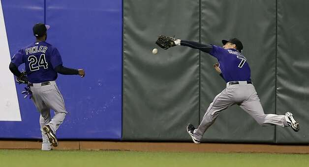 Colorado Rockies right fielder Matt McBride (7) fails to make a catch on a line drive from San Francisco Giants' Brandon Crawford during the fifth inning of a baseball game on Monday, Sept. 17, 2012, in San Francisco. Crawford got a double on the play. (AP Photo/Marcio Jose Sanchez) Photo: Marcio Jose Sanchez, Associated Press