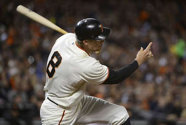 SAN FRANCISCO, CA - SEPTEMBER 17:  Hunter Pence #8 of the San Francisco Giants hits an RBI single driving in Pablo Sandoval #48 (not pictured) in the six inning against the Colorado Rockies at AT&T Park on September 17, 2012 in San Francisco, California.  (Photo by Thearon W. Henderson/Getty Images) Photo: Thearon W. Henderson, Getty Images