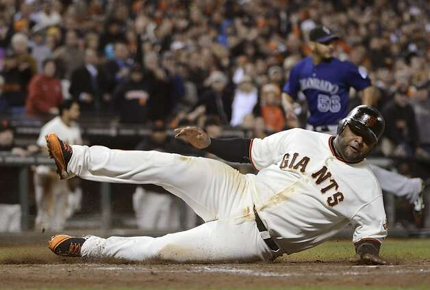 SAN FRANCISCO, CA - SEPTEMBER 17:  Pablo Sandoval #48 of the San Francisco Giants scores on an RBI single from Hunter Pence #8 (not pictured) in the six inning against the Colorado Rockies at AT&T Park on September 17, 2012 in San Francisco, California.  (Photo by Thearon W. Henderson/Getty Images) Photo: Thearon W. Henderson, Getty Images