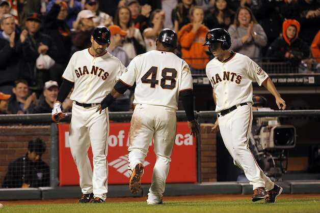 Pablo Sandoval is congratulated after scoring the winning run in the bottom of the sixth inning. The San Francisco Giants played the Colorado Rockies at AT&T Park in San Francisco, Calif., on Monday, September 17, 2012. Photo: Carlos Avila Gonzalez - San Fran, The Chronicle