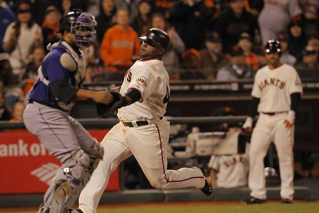 Pablo Sandoval scores the winning run in the bottom of the sixth inning. The San Francisco Giants played the Colorado Rockies at AT&T Park in San Francisco, Calif., on Monday, September 17, 2012. Photo: Carlos Avila Gonzalez - San Fran, The Chronicle