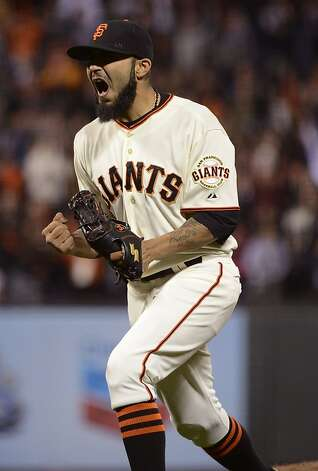 Sergio Romo #54 of the San Francisco Giants celebrate after striking out Jason Giambi #23 of the Colorado Rockies (not pictured) for the final out of the game at AT&T Park on September 17, 2012 in San Francisco, California. The Giants won the game 2-1.  (Photo by Thearon W. Henderson/Getty Images) Photo: Thearon W. Henderson, Getty Images