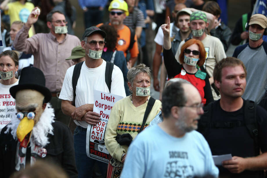 People begin to march during the first anniversary of the Occupy movement on Monday, September 17, 2012 in downtown Seattle. Photo: JOSHUA TRUJILLO / SEATTLEPI.COM