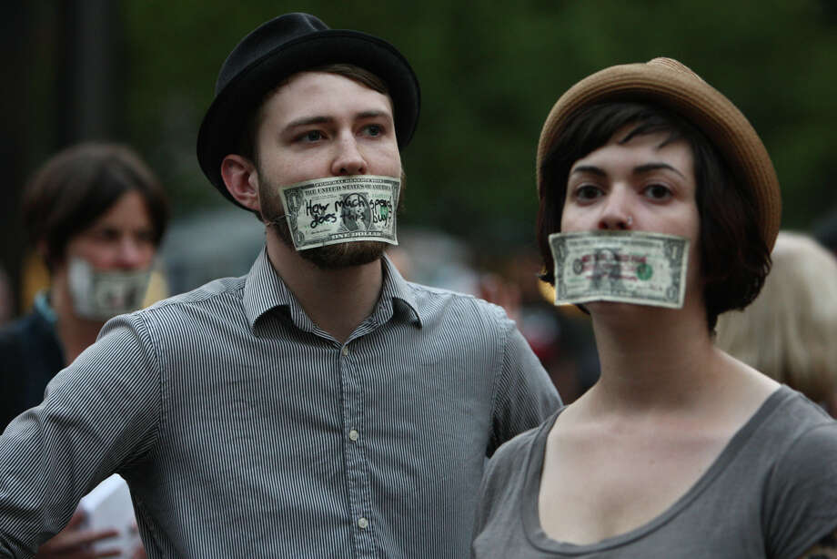 People gather during the first anniversary of the Occupy movement near Westlake Park. Photo: JOSHUA TRUJILLO / SEATTLEPI.COM