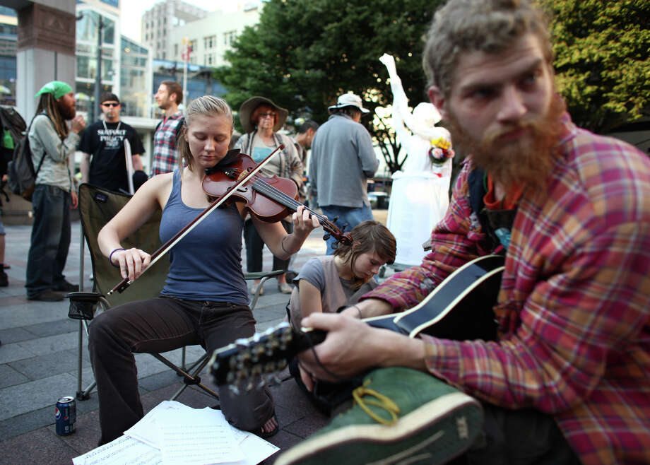 Rachel plays her violin during the first anniversary of the Occupy movement at Westlake Park. Photo: JOSHUA TRUJILLO / SEATTLEPI.COM