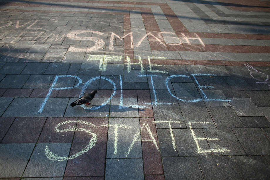 A chalk message is shown during the first anniversary of the Occupy movement at Westlake Park. Photo: JOSHUA TRUJILLO / SEATTLEPI.COM