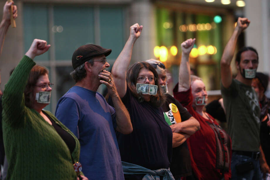 People participate in a silent march during the first anniversary of the Occupy movement in downtown Seattle. Photo: JOSHUA TRUJILLO / SEATTLEPI.COM
