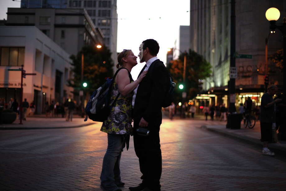 Protesters kiss in the street during the first anniversary of the Occupy movement on Monday, September 17, 2012 near Westlake Park. Photo: JOSHUA TRUJILLO / SEATTLEPI.COM