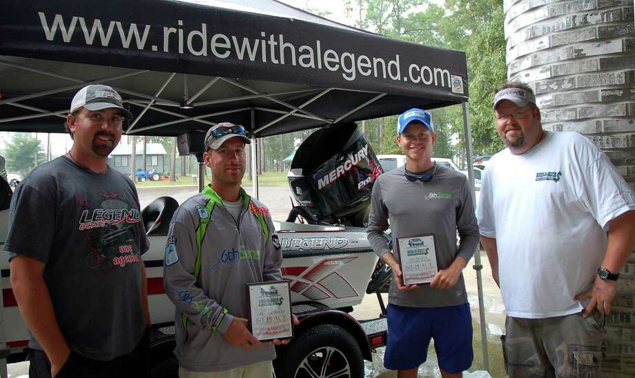 (L-R)  Phillip Crelia of Hometown Tackle and Marine along with Bryan Davis (far right) present the Legend Alpha 191 grand prize to the championship winners Jonathan Garrie and Casey Sobczak  photo by Patty Lenderman, Lakecaster
