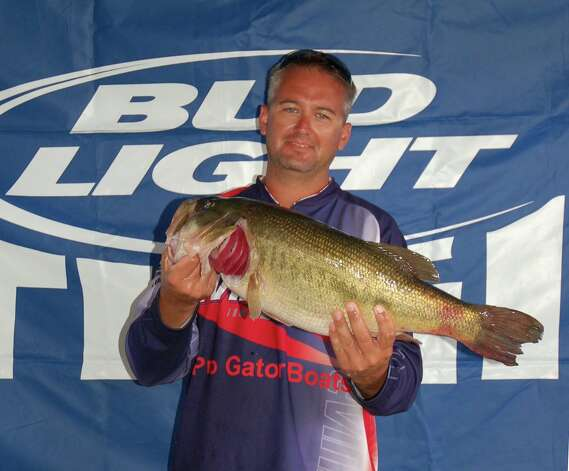Corbett Ross caught the biggest bass over the course of two days, bringing this 9.45 pounder in on day one of the tournament and winning Big Bass.  photo by Patty Lenderman, Lakecaster