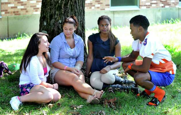 Danbury High School seniors discuss teen pregnancy on Friday, Sept. 14, 2012. From left are; Janet Michala, Aaliyah Chiarito, Jaquana Bell and Corey Acosta, all 17. Photo: Michael Duffy