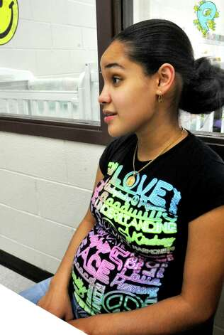 Danbury High School student Darleny Salazar talks about her pregnancy during the Infant and Toddler Program on Friday, Sept. 14, 2012. Photo: Michael Duffy
