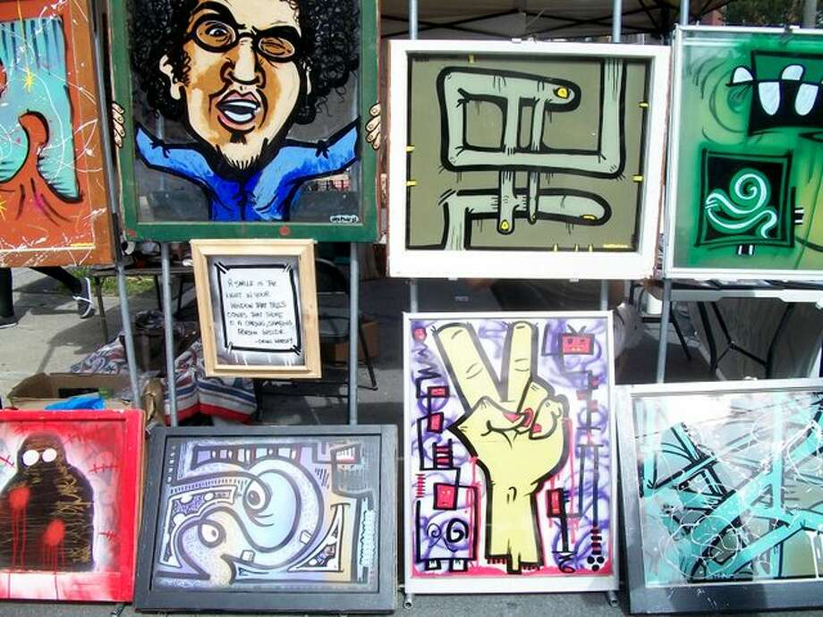 Vendor selling artwork at Larkfest. Photo by Ariella Phillipo. Photo: Picasa, New Visions: Journalism & Media Studies