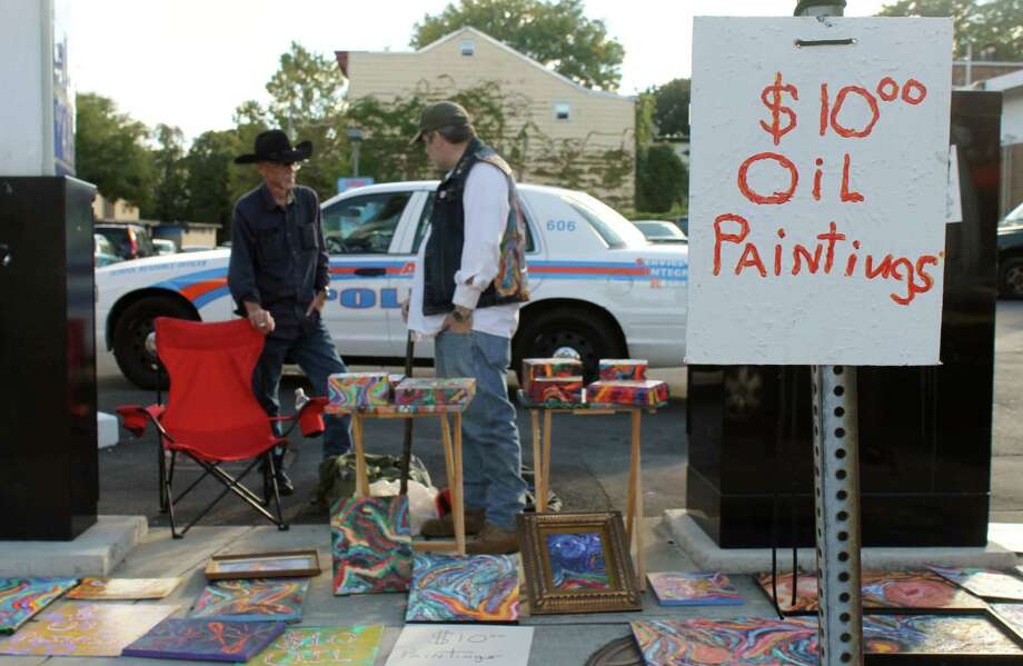 Larkfest attracted many artists, including the painters of these ten dollar, local oil paintings. Photo by Alex Luciano. Photo: New Visions: Journalism & Media Studies