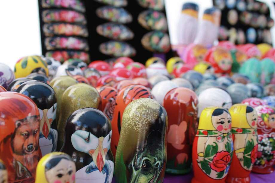 Nesting dolls were one of the many different, interesting trinkets and items displayed at the tents set up on the sidewalks of Lark Street. Photo by Alex Luciano. Photo: New Visions: Journalism & Media Studies