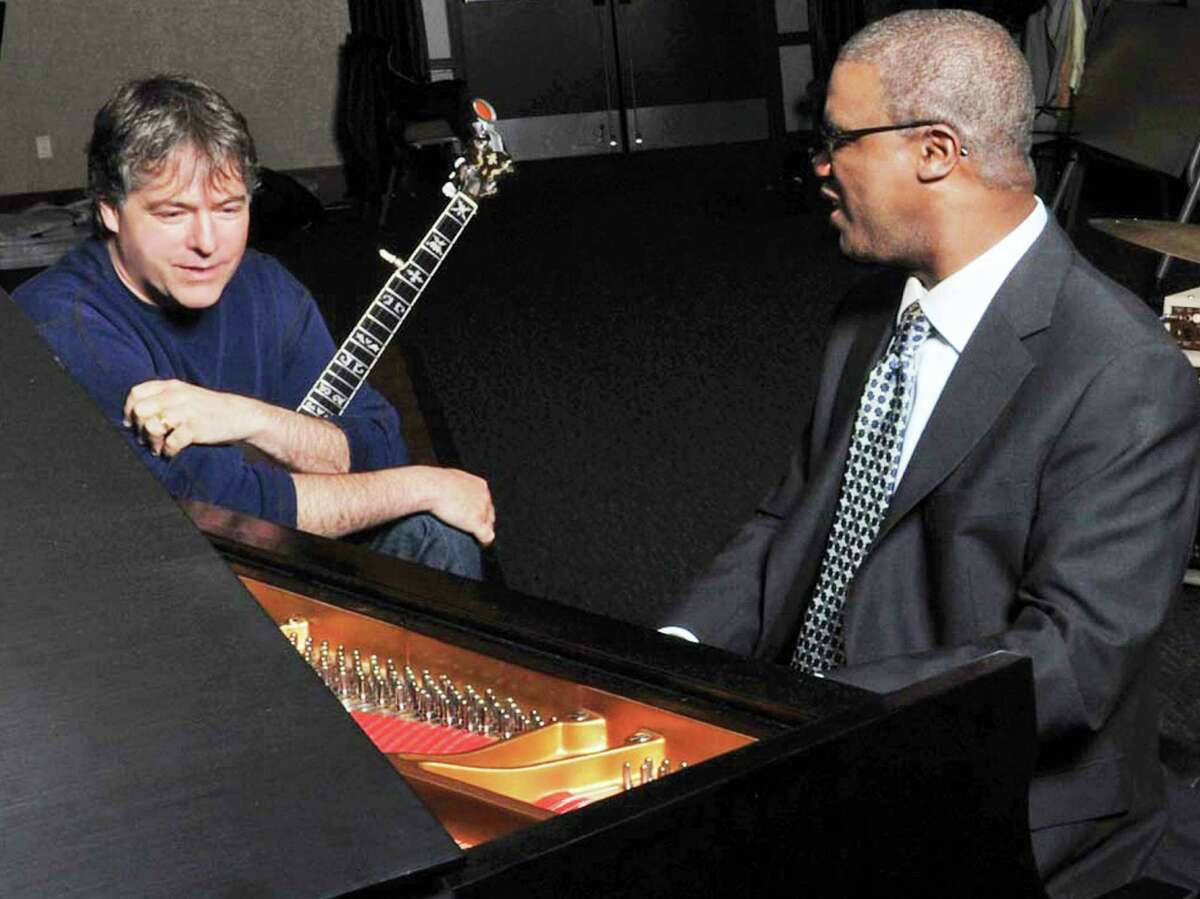 Jazz banjoist Bela Fleck (left) and jazz pianist Marcus Roberts